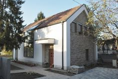 Our customer wanted to build a one-storey family house with attic on a currently built-up corner lot in Dunakeszi, a suburban residential area situated on the bank of the Danube. At the time of design, the lot was al. Cottage Interiors, Interior Design Kitchen, Countryside, Facade, House Plans, Sweet Home, Shed, Outdoor Structures, Building