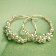 Ive shaped a one inch diameter hoop of gold fill wire and wrapped it with teensy pearls, tiny pearls and little pearls! New to my gem-encrusted hoops collection--these pearly beauties will complement any wardrobe or frame of mind. Your limited edition earrings arrive packaged in my