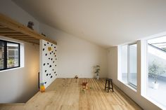 rock climbing wall leading to a multi-use loft - playroom #kids