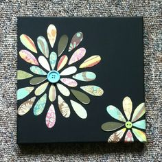 Simple Canvas art! Dollar store canvas, paint black with acrylic, hot glue a button for the center of the flower and hot glue the pedals! Simple! :)