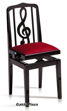 [F] ピアノの椅子。背中の部分がト音記号になっていて可愛い。