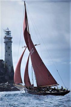 The Jolie Brise passing the Fastnet Rock Lighthouse - West Cork, Ireland