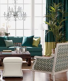 Simple, stylistic details, like the ottomans and patterned pillow in this living room, are essential to making the most of your space.