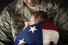 baby wrapped in an american flag