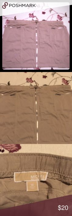 Michael Michael Kors Tan Skirt Zips up the front with draw strings  ties. 100% rayon , . Has the zip pocket on sides . Length is 16 inches. Waist measures side to side 20 inches. Has a silver on ties , zippers  with Michael Kors name on them. Michael Kors Skirts Mini