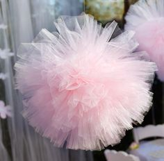 Great idea to use tulle instead of tissue paper for a pom.