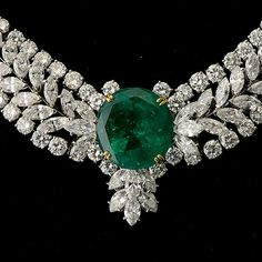 Diamonds surrounding giant emerald.