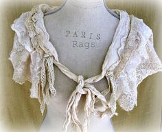 this is a goodie...from old lace slips..and lace and /or crochet table cloth's..minimal sewing...i would make a few..(one i would tea stained dye..!)..its so cool..to have this over a casual..dress/to tee/to sweater..