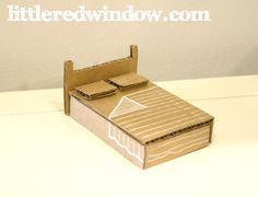 DIY Cardboard Box Doll House | littleredwindow.com | Make a sweet toy doll house from a recycled cardboard box!