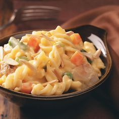 Cheddar Turkey Casserole Recipe -This recipe comes with lots of mass appeal, thanks to its cheesy sauce. Pasta, veggies and leftover turkey combine to create a filling meal. —Steve Foy, Kirkwood, Missouri