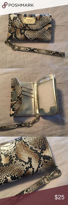Michael Kors Wallet Clutch for Iphone 4/4S/3GS Michael Kors Natural Python Wallet Clutch for Iphone 4/4S. Hardly Used. Like New, because I ended up getting an Iphone 5 right after I bought it. Holds phone and has 3 card slots with detachable wrist strap. Original Box Included. Michael Kors Bags Clutches & Wristlets