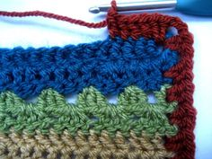 Crocheting blanket edgings is one of my most favourite things, I love the challenge of choosing exactly the right colours and designing exactly the right sort of finish to complete the blanket. This edging was designed specifically for the Cosy. Crochet Border Patterns, Crochet Blanket Border, Crochet Throw Pattern, Striped Crochet Blanket, Scrap Yarn Crochet, Knit Crochet, Knitted Blankets, Baby Blankets, Manta Crochet