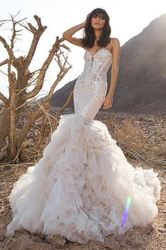 Blush tulle mermaid with sweetheart neckline, ruched bodice with Swarovski appliques, ruffled skirt, illusion corset back, and spaghetti straps with Swarovski crystals. Pnina Tornai 2016 Wedding Dress Collection