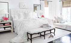 """I like the serenity of pure white linens and very soft muted colors,"" designer Brooke Davenport says of a Southern California master bedroom. The custom headboard is upholstered in a Scalarnandre linen, and the Minotti chaise lounge is covered in a Donghia fabric. Custom nightstands and mirrors. Lamps, Ralph Lauren Home, Cocoon silk duvet over Sferra bed linens. Bone mirror above bed, JF Chen.   - HouseBeautiful.com"