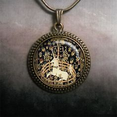 The Unicorn in Captivity glass pendant by MoonGardenDesigns