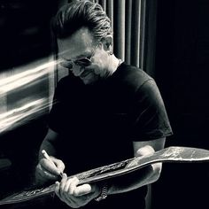 """Bono Signing The Skateboard with Lyrics from """"Where The Streets Have No Name"""""""