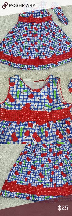 Red Apples Summer Dress. Kids Adorable summer dress with red apples and blue checkers design.   This dress include a matching hair band. Button closer in the back. This item is brand new and never used. Dresses