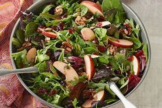 Apples and dried cranberries make this mixed green salad sweet and tart. Serve at a dinner party—or any night you want the family to feel special!