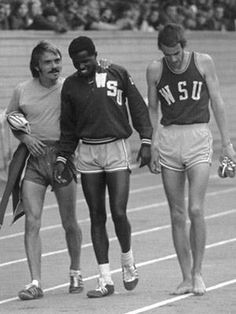 Steve Prefontaine and Washington State runners John Ngeno and Phil Burkwist, April 14, 1973, after the three mile and Pre's historic double races, via Flickr.