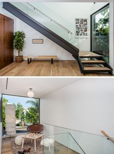 Steel, wood and glass stairs lead you to the second floor of this home, and at the top of the stairs there's a small sitting area with a large window that has views of the street.