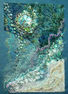 "The title of this mixed media creation is ""Float"" and you can almost hear the water, can't you? This is the work of Carol Walker. Carol embroidered this piece on blue Belgian linen and embellished with paua shells, beads, sequins, netting and salvaged velvet. Carol was inspired by a photo of a bubble trapped in ice formed in a shallow birdbath. See more of Carol's work on her Flickr page at https://www.flickr.com/photos/half_mom-squared/4351742303/in/faves-55780937@N08/"