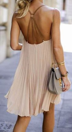 Pleated creamy shift with strappy statement