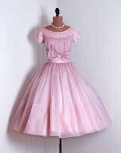 Party Dress: 1950's, semi-sheer silk organza, heavily ruched fitted bow bodice, tulle-lined skirt.