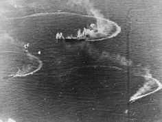 Battle of the Philippine Sea - Japanese aircraft carrier Zuikaku (center) and two destroyers maneuvering while under attack by U.S. Navy carrier aircraft during the late afternoon of 20 June 1944. Zuikaku was hit by several bombs during these attacks but survived.