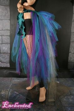 A beautiful bustle to add an extra wow to any costume! Add these to any tutu for extra volume! Perfect for Burlesque dancers and Halloween!    Made from 6 layers and 180yards of soft smooth Bridal tulle in strips of purple, teal, turquoise, dark green, black, royal blue and streamers of gold, that has been gathered, trimmed and sewn to the green ribbon tie. This bustle can fit just about any size! easy to tie on and take off!!    This bustle is not made yet, It is made when ordered…