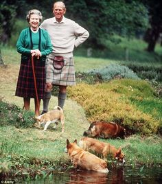 the queen & duke with the corgis in scotland