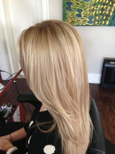 Blonde Balayage highlights and beige blonde dimension. Long layers. Seamless layers. Long layered haircut
