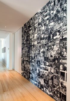I really like this idea for a hallway. But they have to properly fixed to the wall otherwise it will look cheap!  A black and white photo wall...