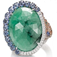 Giovanni Ferraris -White gold ring with diamonds, sapphires and emeralds.