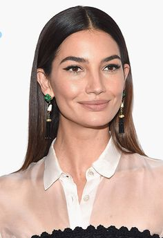 Lily Aldridge's straight locks are worthy of a hair ad: glossy beyond your wildest dreams. After you've washed your hair, condition with some smoothing products (like this Ouai fave) and blow dry with a diffuser. Then, brush using a Tangle Teezer, part in the middle and straighten from root to tip. Finally, tuck behind your ears and finish with a spritz of hold spray