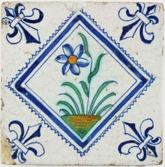 Antique Dutch Delft tile with a polychrome flower in a diamond square, 17th century