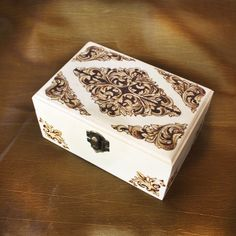 This wooden jewelry box was inspired by baroque style and ornaments you would normally associate with Marie Antoinette. Made using pyrography. Symetrical floral decor is perfect for for your new dressing table box. The inside of the box is fitted with red felt, which you can see on the link. Wood Burning Crafts, Wood Burning Art, Wooden Jewelry Boxes, Wooden Boxes, Dressing Table Boxes, Flower Svg, Red Felt, Baroque Fashion, Quilling Art
