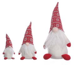 Rasken Tomte in all different sizes. Scandinavian knitted winter hat & a bean bag bottom for stability. SO Cute!