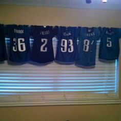 Kids sports bedroom valance. Just string their old jerseys that they've grown out of on to a curtain rod.