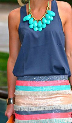 Love this turquoise necklace and colorful skirt !