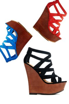 It's Raining shoes! Sculpted Faux wood wedge featuring lush straps with caged design and back zip to secure your step. In 3 colors Blue, Black, and Red!