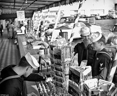 Sailors on leave at Fisherman's Wharf buying souvenirs in San Francisco sometime between 1940-1960