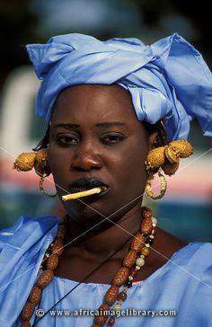 Wolof woman wearing a traditional blue dress, Banjul, the Gambia.