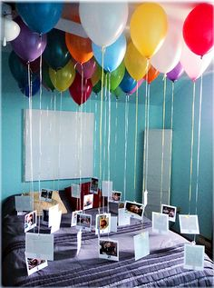 fill 30 balloons with helium, attach a ribbon with a photo for each year of the person's life at the end of the balloon.  Gather them all together (I used the bed for photo support) in any room in your house and wait for the birthday surprise.