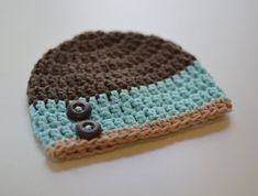 Adorable crochet beanie, that is custom made especially for you! You pick the colors and the size. This beanie can be made with or without the buttons. Available hat sizes: Newborn fits up to 2 weeks old, perfect for the hospital or newborn pictures. 0-3 months fits 14-15 inches