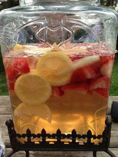 Strawberry Lemon Sangria!  Slice:  1 cup strawberries, 1 lemon, 1 apple, 1 bottle white wine, 1/2 cup white rum,  4 cups sprite