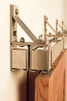 This stainless box rail bypass barn door hardware can hold a door up to 400 lbs and is made from high grade solid stainless steel. Use this kit for both interior and exterior barn doors. Sliding Door Track, Barn Door Track, Sliding Door Systems, Sliding Doors, Sliding Door Window Treatments, Bypass Barn Door Hardware, Sliding Barn Door Hardware, Door Hinges, Door Brackets