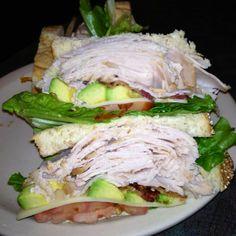 "Chompie's ""Stevie G's 5-Town Special"" sandwich - Roasted turkey, bacon, avocado, jack cheese, lettuce, tomato & mayo on Chompie's multi-grain bread  www.chompies.com"