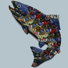 Wall-mounted painted fish made from recycled bottle caps. Photo by Sam Fein.