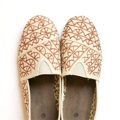 Create your very own pair of Toms knock-offs! Plain canvas shoes are given a quick update with a fun design using fabric markers.