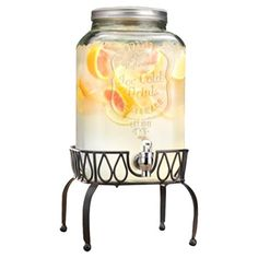 Glass mason jar-inspired beverage dispenser on a black metal openwork stand.  Product: Beverage dispenser and stand Con...